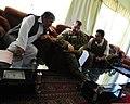 U.S. Army Lt. Col. Anthony Ulrich, center, the Farah Provincial Reconstruction Team (PRT) civil affairs commander, discusses security with Abdul Ghafaar, left, the Farah chief prosecutor, in Farah city, Farah 120829-N-II659-1199.jpg