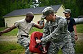 U.S. Army Sgt. Chavis Avery, left, with Headquarters and Headquarters Company, 105th Military Police Battalion, North Carolina Army National Guard, makes his way through a defense course 130501-Z-AY498-002.jpg