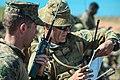 U.S. Marine Corps Capt. Brian M. Ellis, left, the air officer for Battalion Landing Team, 2nd Battalion, 4th Marine Regiment, 31st Marine Expeditionary Unit, coordinates with Australian Army Bombardier Corey W 130803-M-PZ610-008.jpg