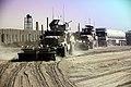 U.S. Marine vehicles lead civilian fuel trucks during an escort mission outside Shir Ghazay, Helmand Province, Afghanistan, October 19, 2011 111019-M-KL854-001.jpg