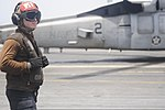 U.S. Navy Aviation Maintenance Administrationman 2nd Class Joel Cooper, assigned to Helicopter Sea Combat Squadron (HSC) 6, monitors flight operations as an MH-60S Seahawk helicopter prepares to launch from 130611-N-GA424-003.jpg
