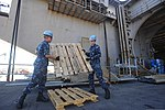 U.S. Navy Aviation Maintenance Administrationman Airmen Matt Hall and Darrin Corbo unload pallets from the aircraft carrier USS Dwight D. Eisenhower (CVN 69) Aug. 26, 2013, at Naval Station Norfolk, Va 130826-N-EJ625-008.jpg