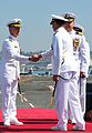 U.S. Navy Capt. Thom Burke, left, shakes hands with Rear Adm. Patrick Hall, the commander of Carrier Strike Group 9, following a change of command ceremony aboard the aircraft carrier USS Ronald Reagan (CVN 76) 130813-N-AV746-376.jpg
