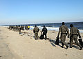 U.S. Sailors walk to the staging point at a beach before an open ocean swim during a Special Warfare Combatant-craft Crewmen training exercise near Virginia Beach, Va., Feb. 4, 2010 100204-N-KM848-013.jpg
