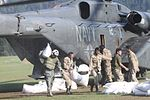 U.S. Sailors with Helicopter Mine Countermeasures Squadron (HM) 15, Detachment 2 help Pakistani soldiers load relief supplies onto a U.S. Navy MH-53E Sea Dragon helicopter during humanitarian relief efforts 100821-M-ZG155-409.jpg