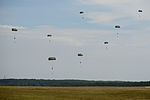 U.S. Soldiers with the 1st Battalion, 10th Special Forces Group descend to the ground at the 7th U.S. Army Joint Multinational Training Command's Grafenwoehr Training Area in Bavaria, Germany, after jumping from 130807-A-BS310-094.jpg