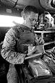 U. S. Marine Cpl. Timothy Sanderson with Transportation Support Company, Combat Logistics Regiment 2, 2nd Marine Logistics Group, eats a meal ready to eat (MRE) inside his Mine-Resistant Ambush Protected (MRAP) 120829-M-KS710-050.jpg
