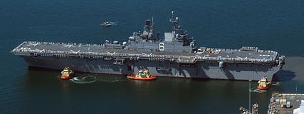 An aerial view of USS America coming into port in San Diego, California, 15 September 2014