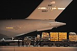 US Air Force 100113-F-5735S-541 Airmen load C-17s for Haitian relief.jpg
