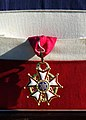 US Navy 020924-N-2383B-502 A close up shot of the Legion of Merit as it hangs on a presentation frame which was presented to Vice Admiral Cees van Duyvendijk, Commander in Chief, Royal Netherlands Navy.jpg
