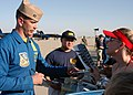 US Navy 040320-N-6060O-379 Lt. Craig Olson, a pilot assigned to the U.S. Navy flight demonstration team, the Blue Angels, signs autographs for excited fans after the annual air show aboard Naval Air Station Lemoore, Calif.jpg