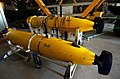 US Navy 040709-N-6932B-023 Battle-Space Preparation Autonomous Underwater Vehicles (BPAUV) on the mission deck of High-Speed Vessel Swift (HSV 2) stand down after a night-time training mission.jpg