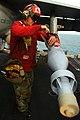 US Navy 041119-N-4757S-263 Aviation Ordnanceman 3rd Class Joshua Silva, attaches a stabilizer fin to a GBU-16 1000 pound laser-guided bomb.jpg
