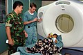 US Navy 050411-N-8629M-198 Lt. Cmdr. Henry Pallatroni, right, and Indonesian Military Capt. Wendy Budiawan discuss an Indonesian patient who is prepared for a Computed Axial Tomography (CAT) scan.jpg