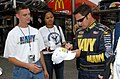 US Navy 050924-N-4729H-065 U.S. Navy Hull Technician 2nd Class Jacob Edwards and Navy Counselor 2nd Class Raihna Campos receive autographs from the Navy ^14 race car driver David Stremme at the Dover International Speedway.jpg