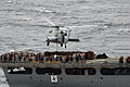 US Navy 051204-N-5387K-084 An MH-60S Seahawk helicopter transports a pallet of supplies on the stern of the Military Sealift Command (MSC) combat stores ship USNS Niagara Falls (T-AFS 3).jpg