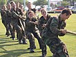 US Navy 060516-N-5215E-002 A team of midshipmen struggle in a round of tug-of-war during.jpg