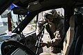 US Navy 060620-M-0008D-003 U.S. Navy Hospital Corpsman 3rd Class William T. Corso searches inside a vehicle for insurgent propaganda during a snap vehicle checkpoint patrol in the city of Ramadi.jpg