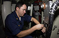 US Navy 061018-N-5060B-023 Chief Gas Turbine Systems Technician Electrical David Smith changes out a heater element on the ship's dehumidifier. Smith is currently stationed aboard the guided-missile frigate USS Klakring (FFG 42.jpg