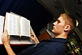 US Navy 070224-N-9928E-045 Airman Rick Mowry places a Bible in the chapel for Catholic Mass aboard Nimitz-class aircraft carrier USS John C. Stennis (CVN 74).jpg