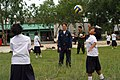 US Navy 080616-N-3581D-201 Seaman Francheska Montoya, assigned to the amphibious dock landing ship USS Tortuga (LSD 46), plays volleyball with students from the Ban Kao Chan Primary School.jpg