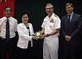 US Navy 080624-N-8177C-004 Vice Adm. Doug Crowder, commander, U.S. 7th Fleet, presents a plaque Vice Minister Nguyen Thi Xuyan during a meeting in Hanoi.jpg