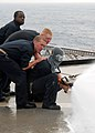 US Navy 080909-N-3392P-028 Sailors participate in a damage control Olympics aboard the amphibious dock landing ship USS Carter Hall (LSD 50).jpg