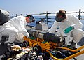 US Navy 081023-N-3483C-006 Gunner's Mate 3rd Class Justin Headley nd Gunner's Mate 2nd Class Cory Spurlock clean up a simulated fuel spill.jpg