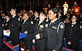 US Navy 090610-N-8848T-551 Navy Junior ROTC cadets from Hyman G. Rickover Naval Academy are acknowledged by their family and loved ones at Copernicus Foundation Theater.jpg