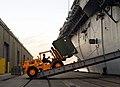 US Navy 100115-N-5345W-071 A forklift driver loads relief supplies aboard the multi-purpose amphibious assault ship USS Bataan (LHD 5).jpg