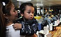 US Navy 100618-N-5716H-061 A child looks at his father, Culinary Specialist 2nd Class Rowin Lameque, during a Father's Day celebration lunch aboard the U.S. 7th Fleet command ship USS Blue Ridge (LCC 19).jpg