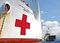 US Navy 100811-N-4044H-220 The Military Sealift Command hospital ship USNS Mercy (T-AH 19) loads cargo aboard the Royal Australian Navy heavy landing craft HMAS Labuan (L128).jpg