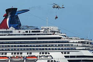 Carnival Splendor - A U.S. Navy helicopter delivering supplies to Carnival Splendor