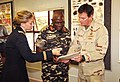 US Navy 110429-F-XM360-080 Chief Explosive Ordnance Technician Justin Berlien, right, presents Namibian Defense Force (NDF) Major General Angula Sh.jpg