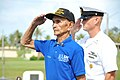 US Navy 110603-N-RR409-718 World War II veteran Manuel Diaz, left, and Command Master Chief Paul Kingsbury salute a wreath during a ceremony in com.jpg