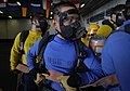 US Navy 110726-N-ZZ999-289 Aviation Boatswain's Mate (Handling) Airman Rae Valencia mans a hose team during hangar bay drills aboard USS John C. St.jpg