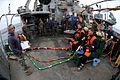 US Navy 110729-N-EF447-034 U.S. Navy Divers conduct a dive supervisor brief before dive operations aboard USNS Grasp (T-ARS 51).jpg