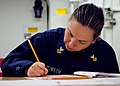 US Navy 120119-N-ZF681-253 Yeoman 1st Class Anna Howeth takes the navy-wide chief petty officer advancement exam aboard the guided-missile destroye.jpg