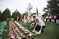 United States Military Order of the Cootie lay wreaths at the Argonne Cross in Arlington National Cemetery (30548872392).jpg