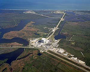 Kennedy Space Center Launch Complex 39 - Aerial view of Launch Complex 39, showing the Vehicle Assembly Building (front), and launch pads 39B (back left) and 39A (back right)