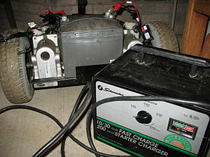 Lead–acid battery - Charge current needs to match the ability of the battery to absorb the energy. Using too large a charge current on a small battery can lead to boiling and venting of the electrolyte. In this image a VRLA battery case has ballooned due to the high gas pressure developed during overcharge.