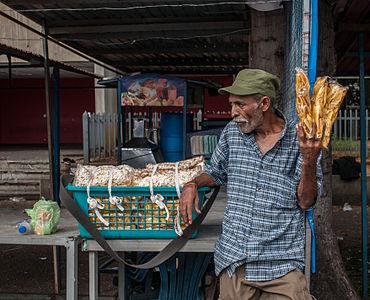 Vendedor de Plátano frito, cotufas y maní