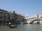 Venice in summer, with the Rialto Bridge in the background.