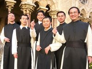 Cistercians - Vietnamese Cistercian monks standing in a cloister and wearing their religious habits