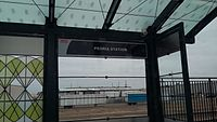 View from RTD commuter train at Peoria Station train station sign during A-Line opening.jpg