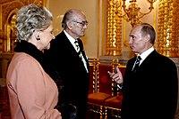 Vladimir Putin with Prince and Princess Dimitri of Russia.jpg