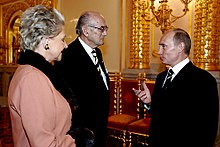 Vladimir Putin with Prince and Princess Dimitri of Russia.jpg