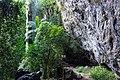 Waterfall Cascading over a Massive Rock Overhang.jpg