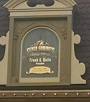 Frank Wells - Wells' window on Main Street USA, in Walt Disney World above the Crystal Arts store, which is inscribed to honor his love of climbing and attempt at completing the Seven Summits.