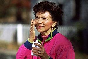 Skin care - A woman applying sunscreen